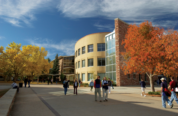 Students walk in the plaza near the Morgan Library, Colorado State University.